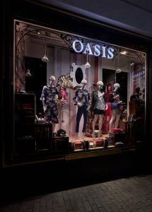 Oasis window design retail display window display bespoke props manufacture visual merchandising company