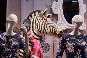 Oasis window design retail display window display bespoke props manufacture visual merchandising company